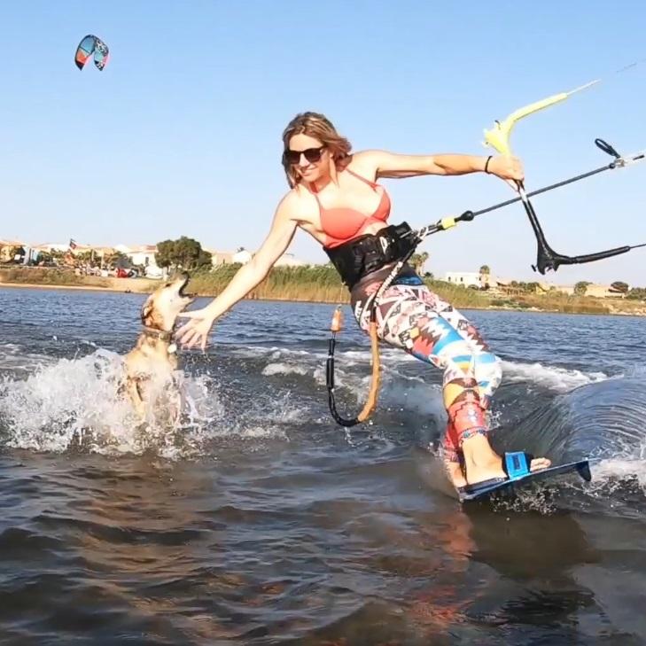 Magda kitelab kitesurfing school Sicily riding with patatina dog