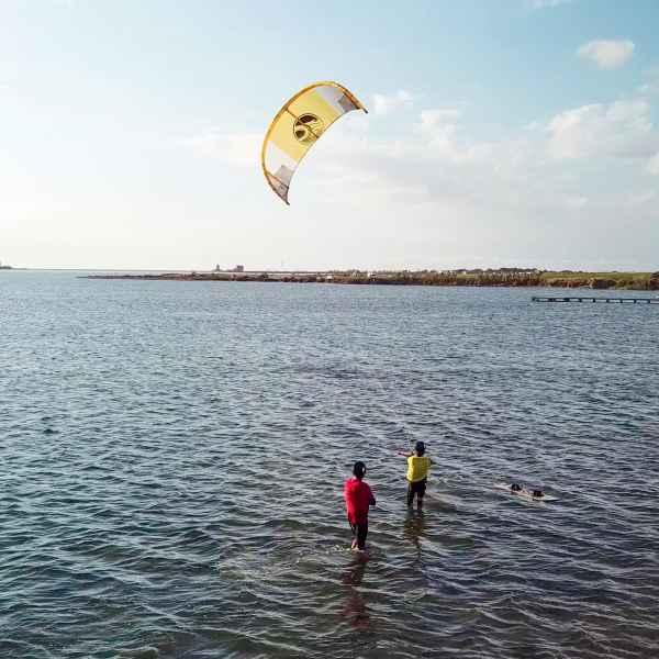 lo stagnone kitesrufing school drone shot; sicily kitesurf